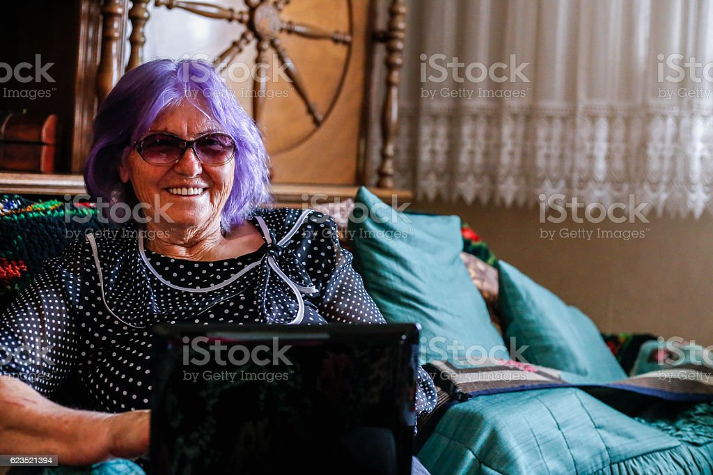 Senior woman using a laptop computer at home stock photo