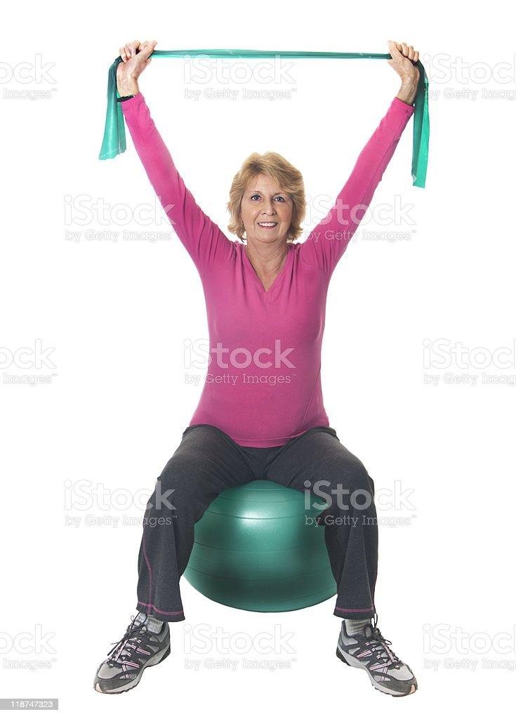 Senior woman using band and exercise ball royalty-free stock photo