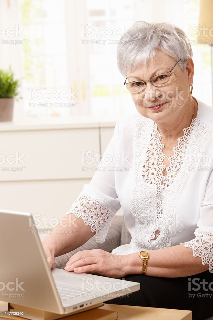 Senior woman using computer royalty-free stock photo
