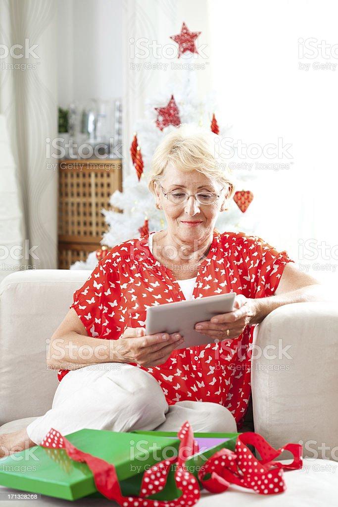 Senior woman using digital tablet royalty-free stock photo
