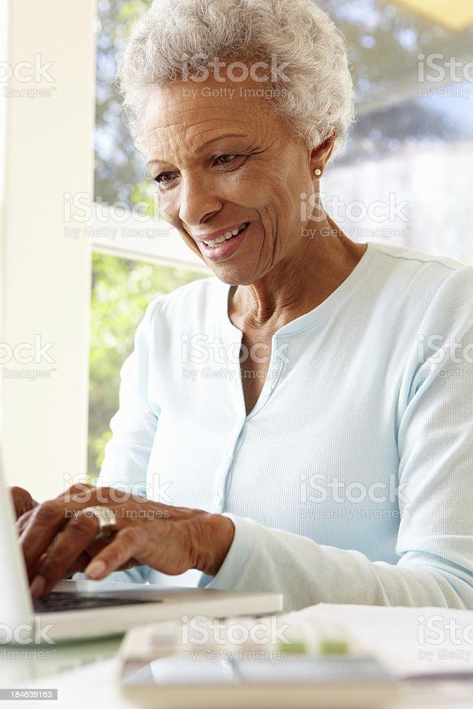 Senior Woman Using Laptop At Home royalty-free stock photo