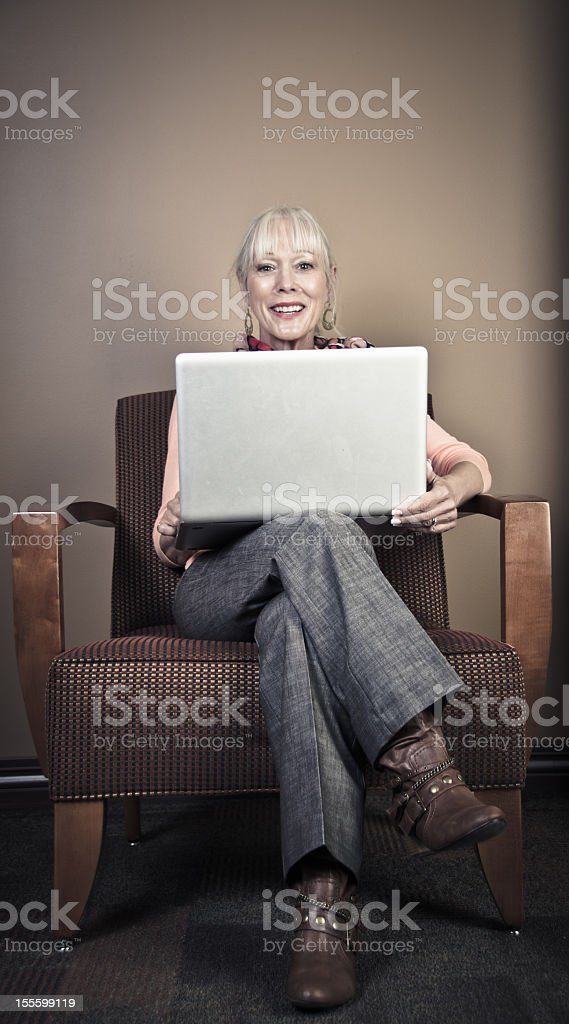Senior Woman Using Laptop Computer royalty-free stock photo