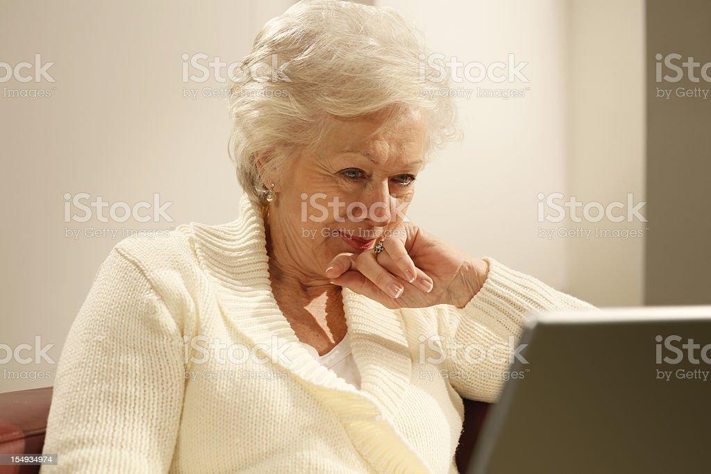 senior woman using laptop royalty-free stock photo
