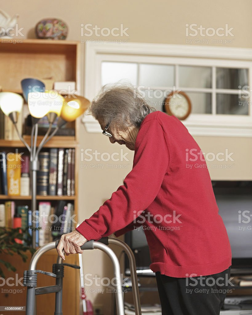 Senior Woman Using Orthopedic Walker at Home stock photo