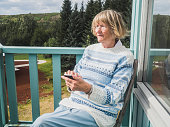 Senior woman using smart phone outdoors