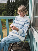Senior woman using smart phone outdoors