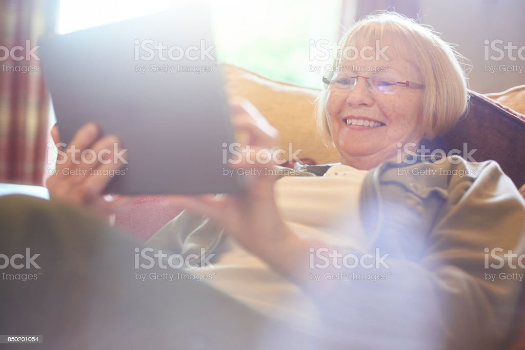 senior woman using social media stock photo