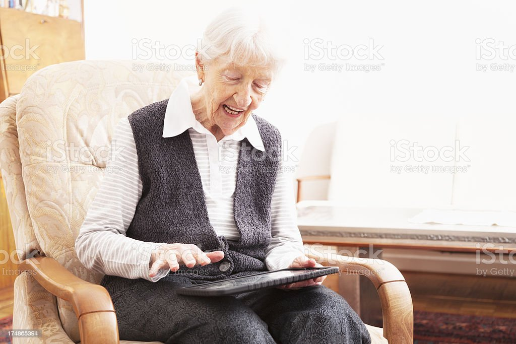 senior woman using tablet pc royalty-free stock photo