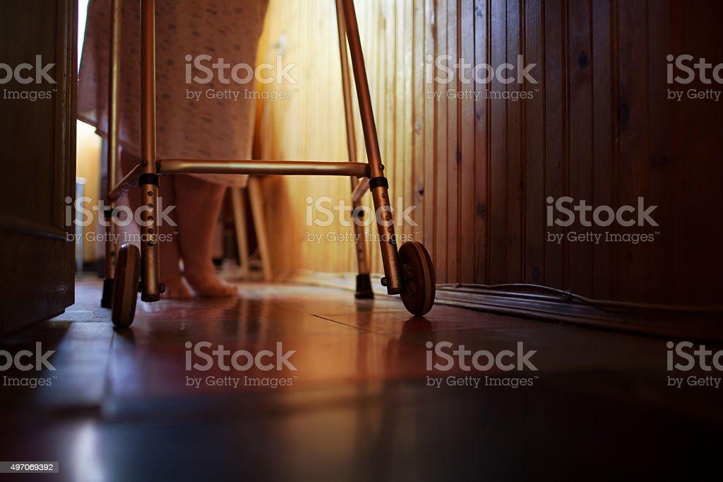 Senior woman using walker at home stock photo