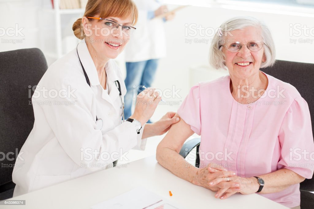 Senior woman visiting doctor. stock photo
