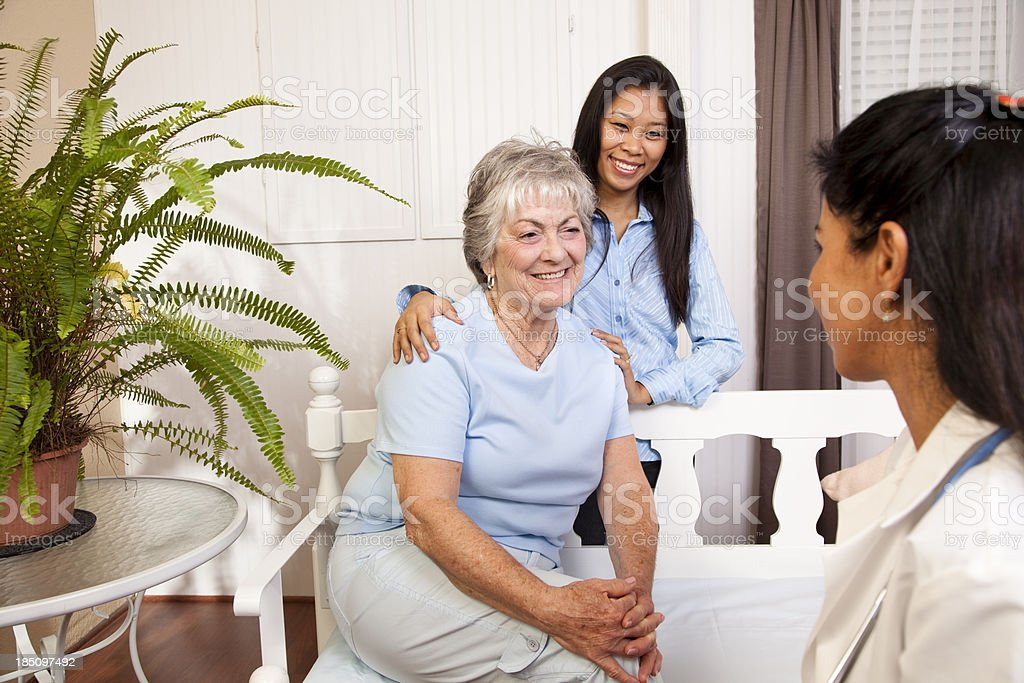Senior woman visitring with home health nurse royalty-free stock photo