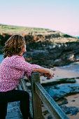 Senior woman waching at the sea