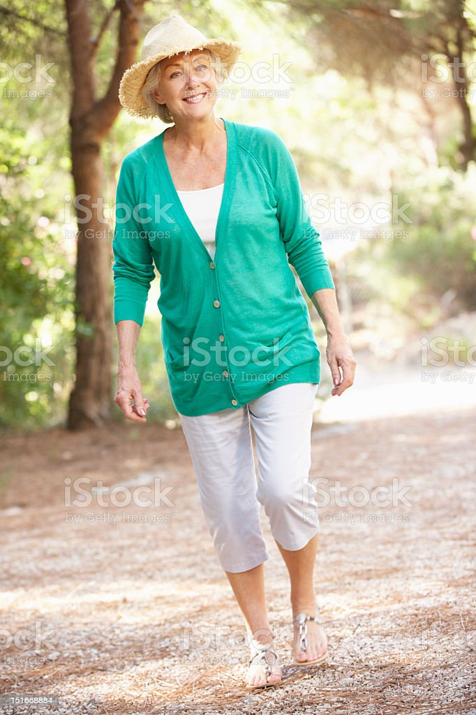 Senior Woman Walking In Countryside royalty-free stock photo