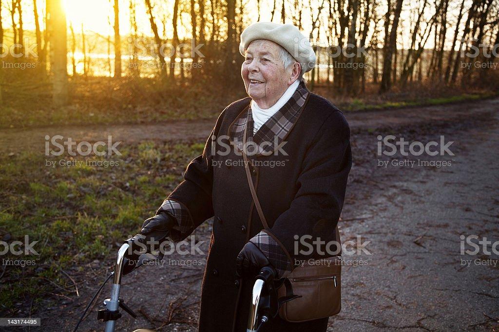 senior woman walking in winter stock photo