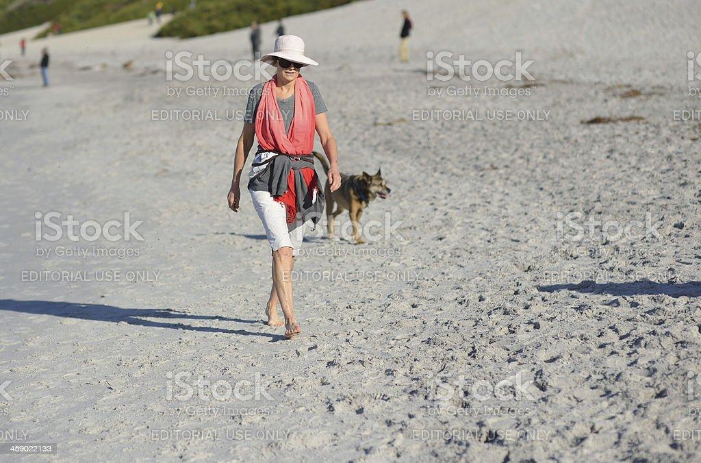 Senior woman walking on the beach in California royalty-free stock photo