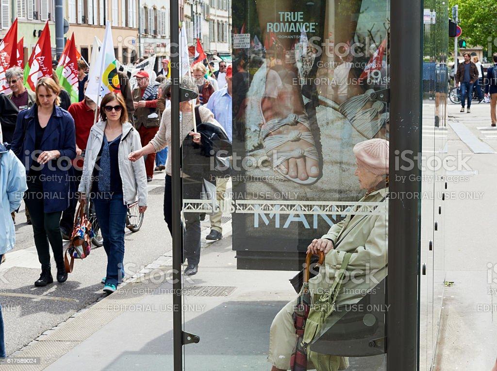 Senior woman watching protestor stock photo