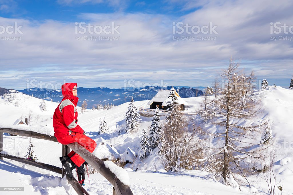Senior woman watching the landscape at Velika Planina, Slovenia stock photo