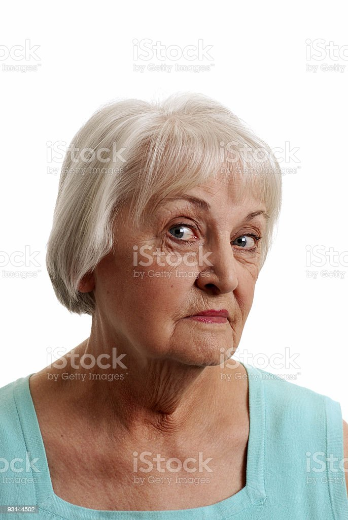 Senior woman wearing a light blue top royalty-free stock photo