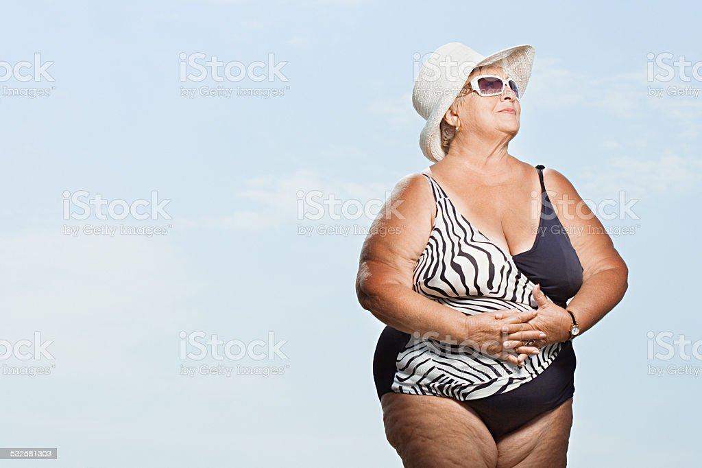 Senior woman wearing a swimming costume stock photo