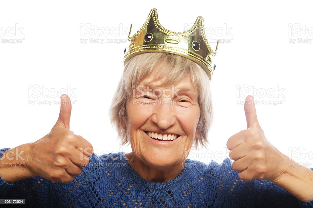 Senior woman wearing crown doing funky action stock photo