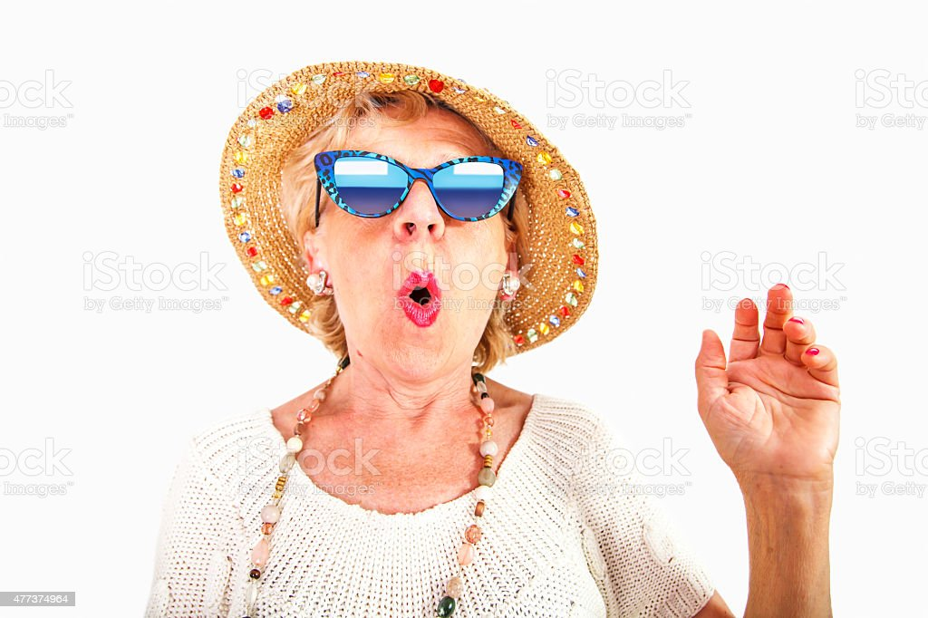 Senior woman wearing sunglasses and hat stock photo