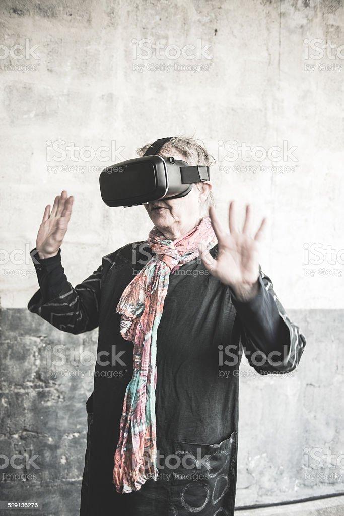 Senior Woman Wearing Virtual Reality Headset, Paris, France stock photo