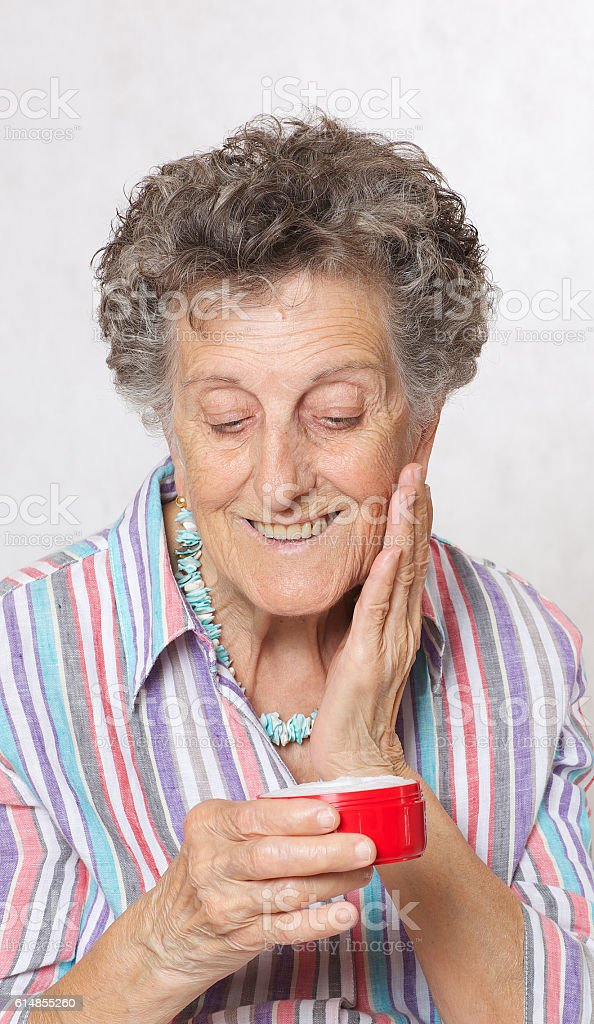 Senior woman with a box of face cream stock photo