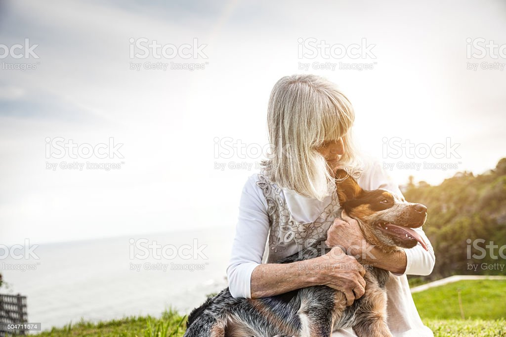 Senior woman with a dog stock photo