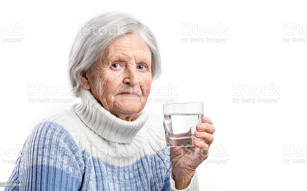 Senior woman with a glass of water stock photo