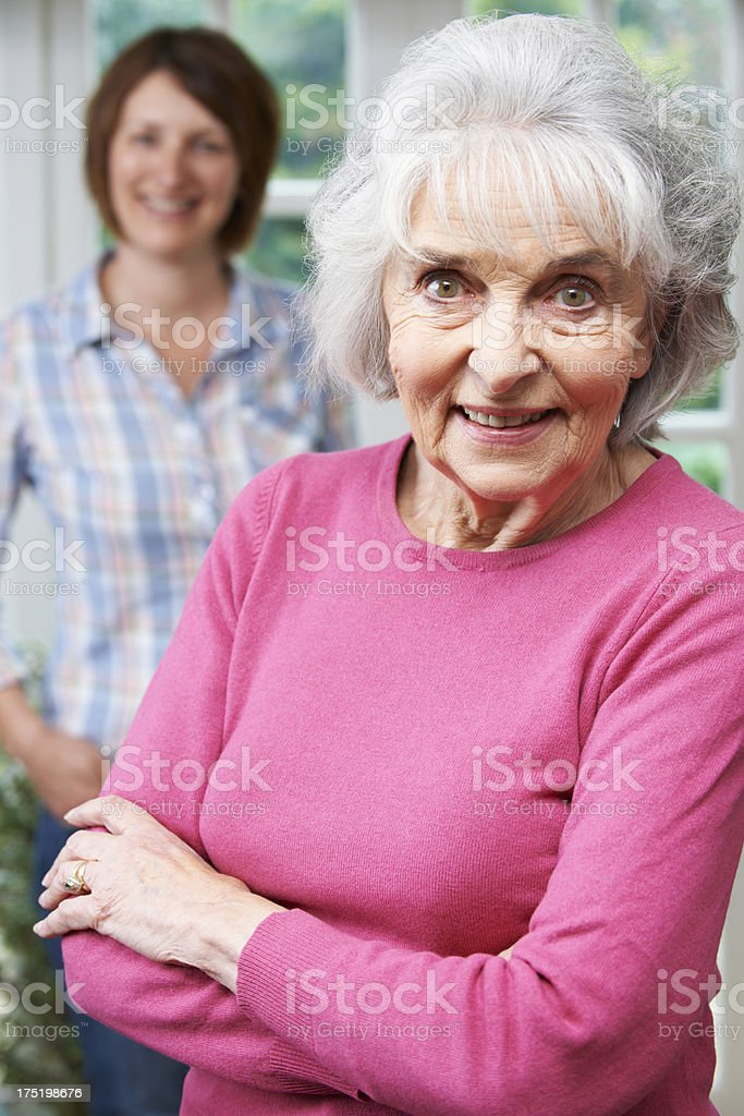 Senior Woman With Adult Daughter At Home stock photo