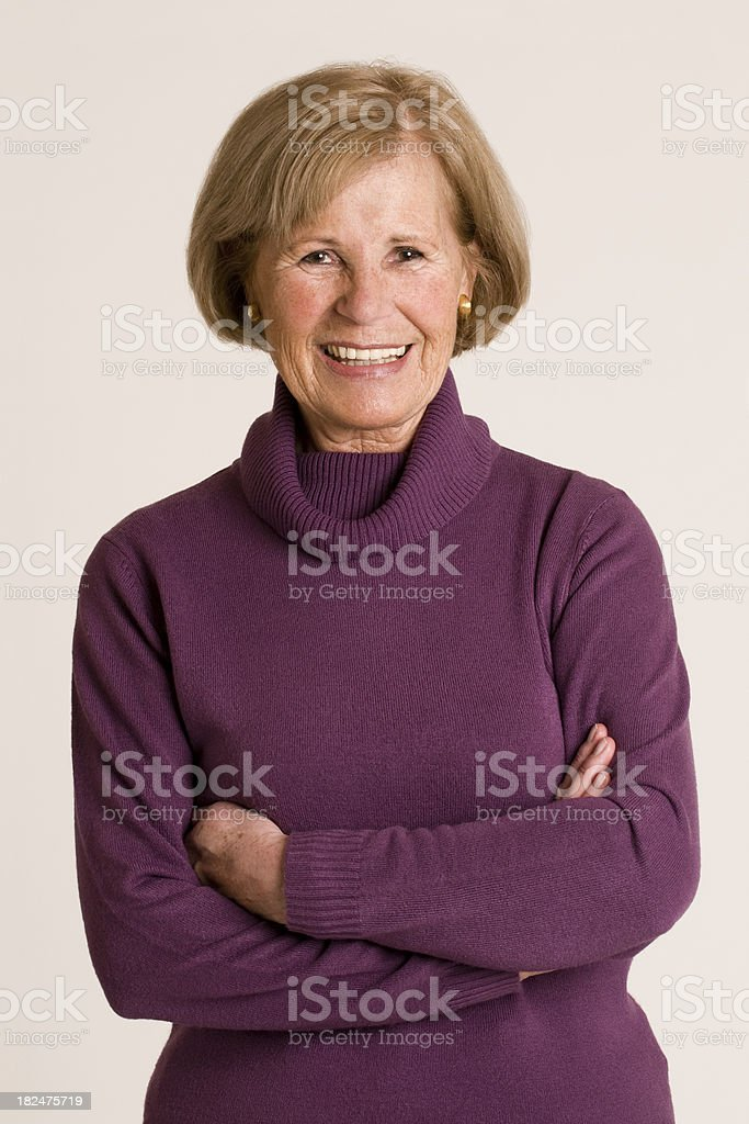 senior woman with arms crossed royalty-free stock photo