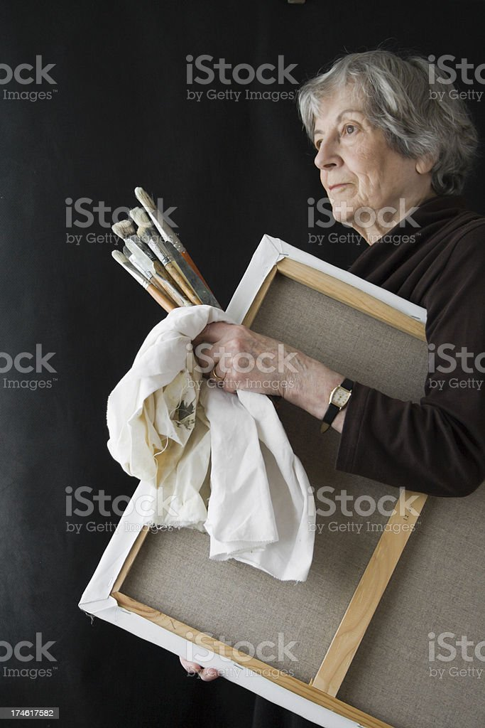 Senior Woman with Artists' Canvas. royalty-free stock photo