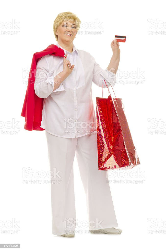 Senior woman with bag and credit card royalty-free stock photo