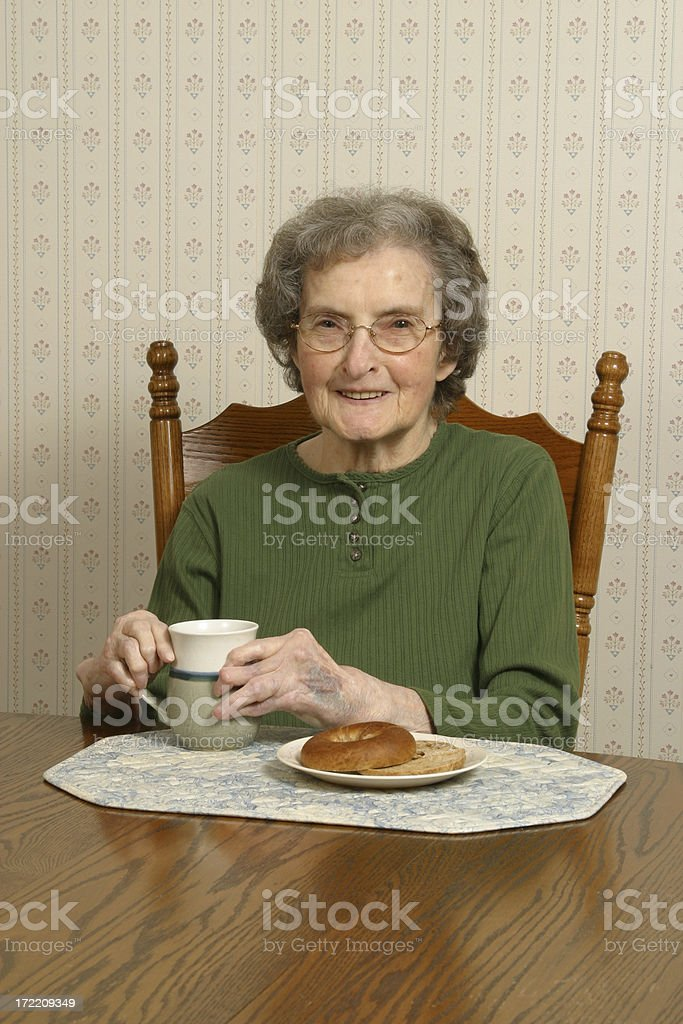 Senior Woman With Bagel and Coffee royalty-free stock photo