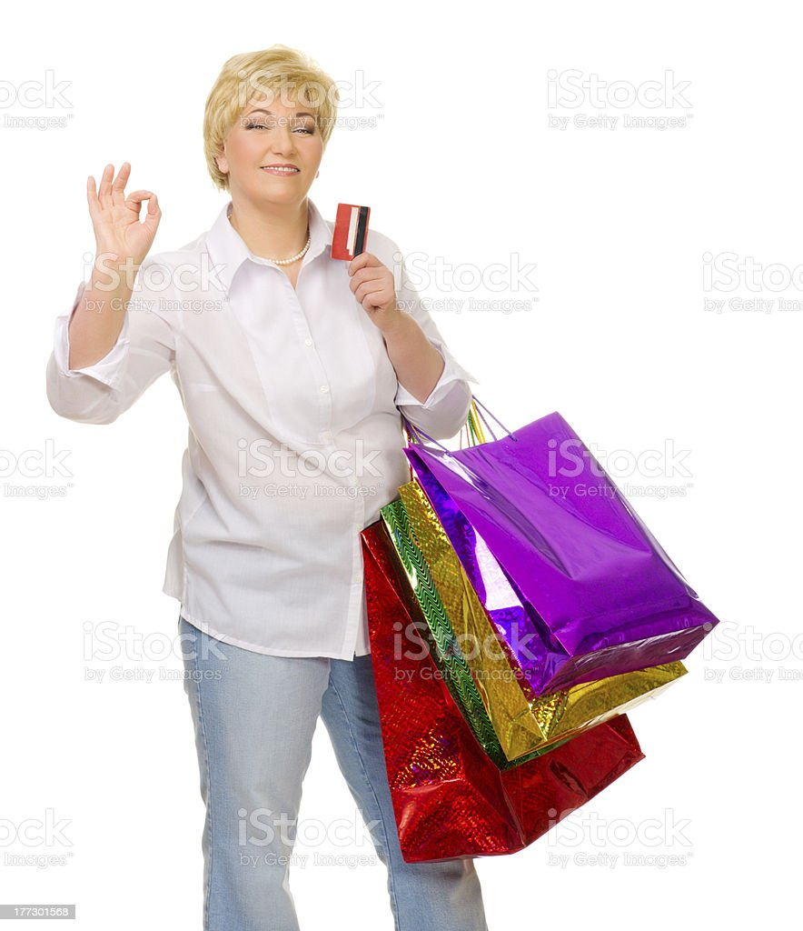Senior woman with bags and credit card royalty-free stock photo