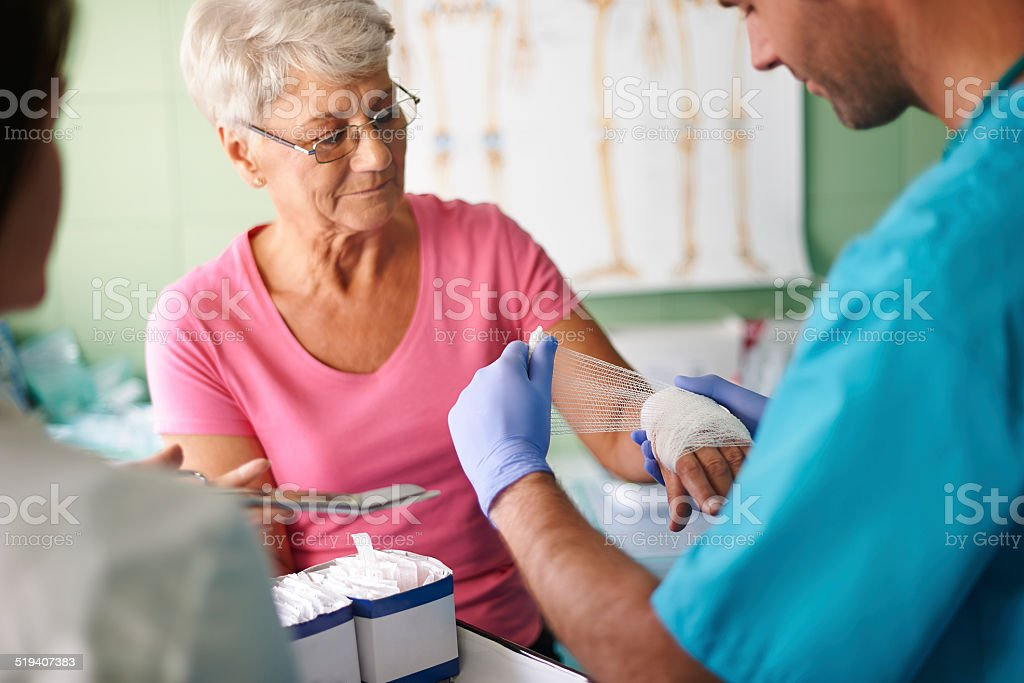 Senior woman with bandage on the hand stock photo