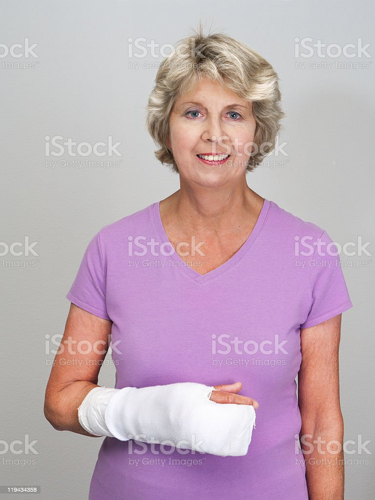 Senior woman with bandaged wrist and hand stock photo