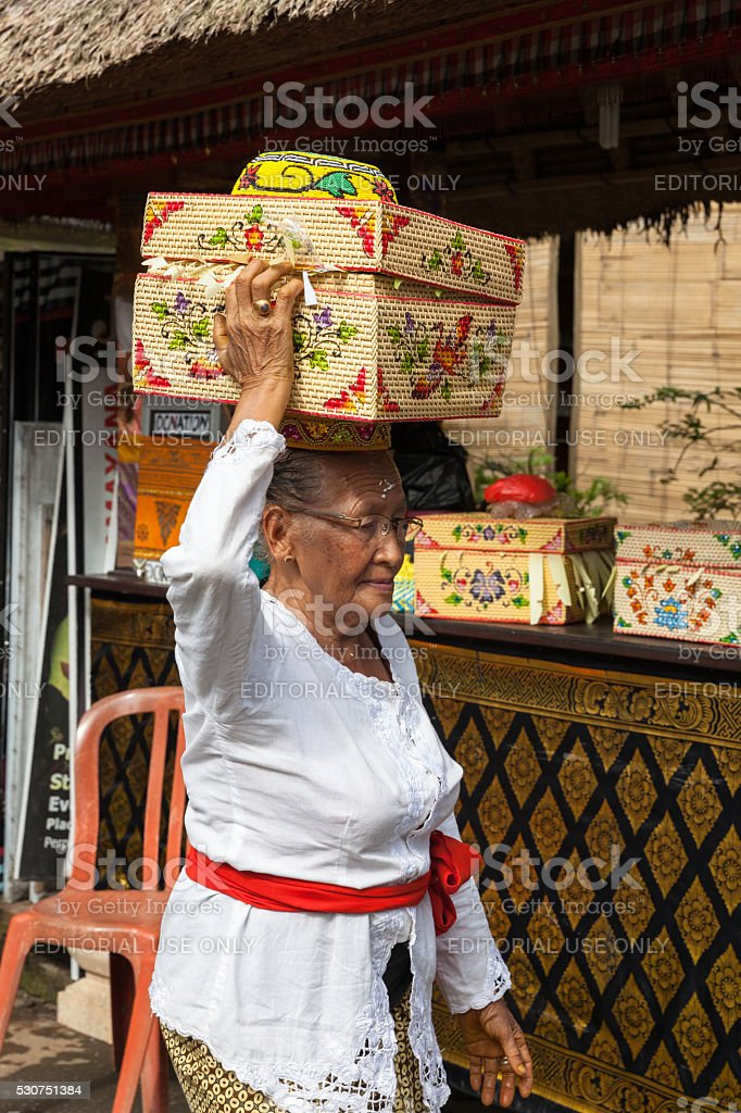 Senior woman with basket on the head stock photo