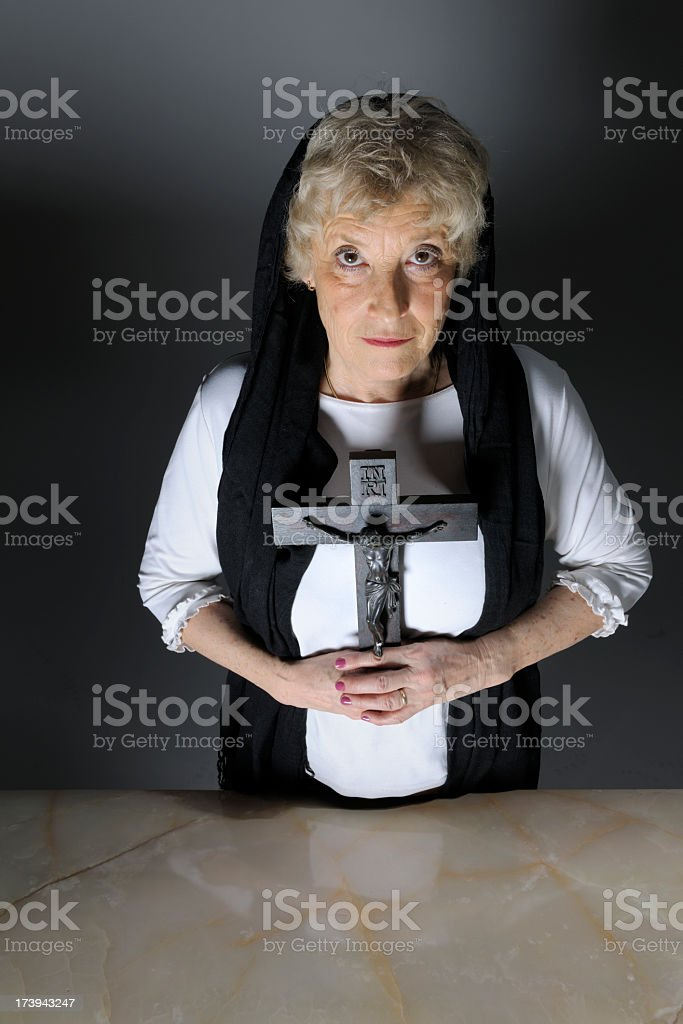 senior woman with black veil holding crucifix royalty-free stock photo