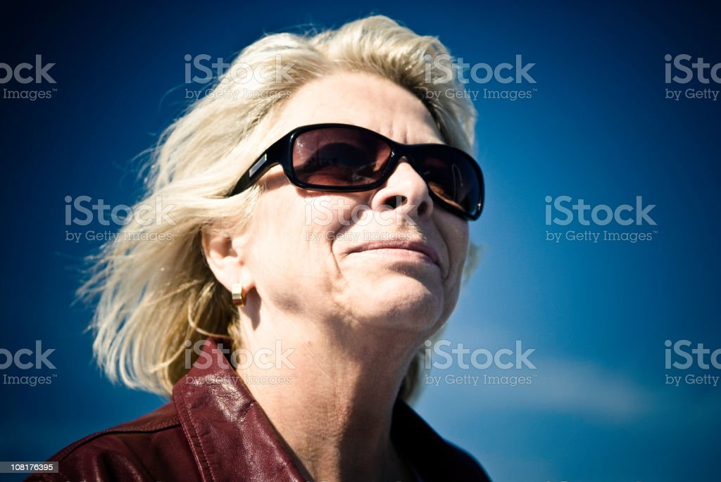 Senior Woman with Blue Sky Background royalty-free stock photo