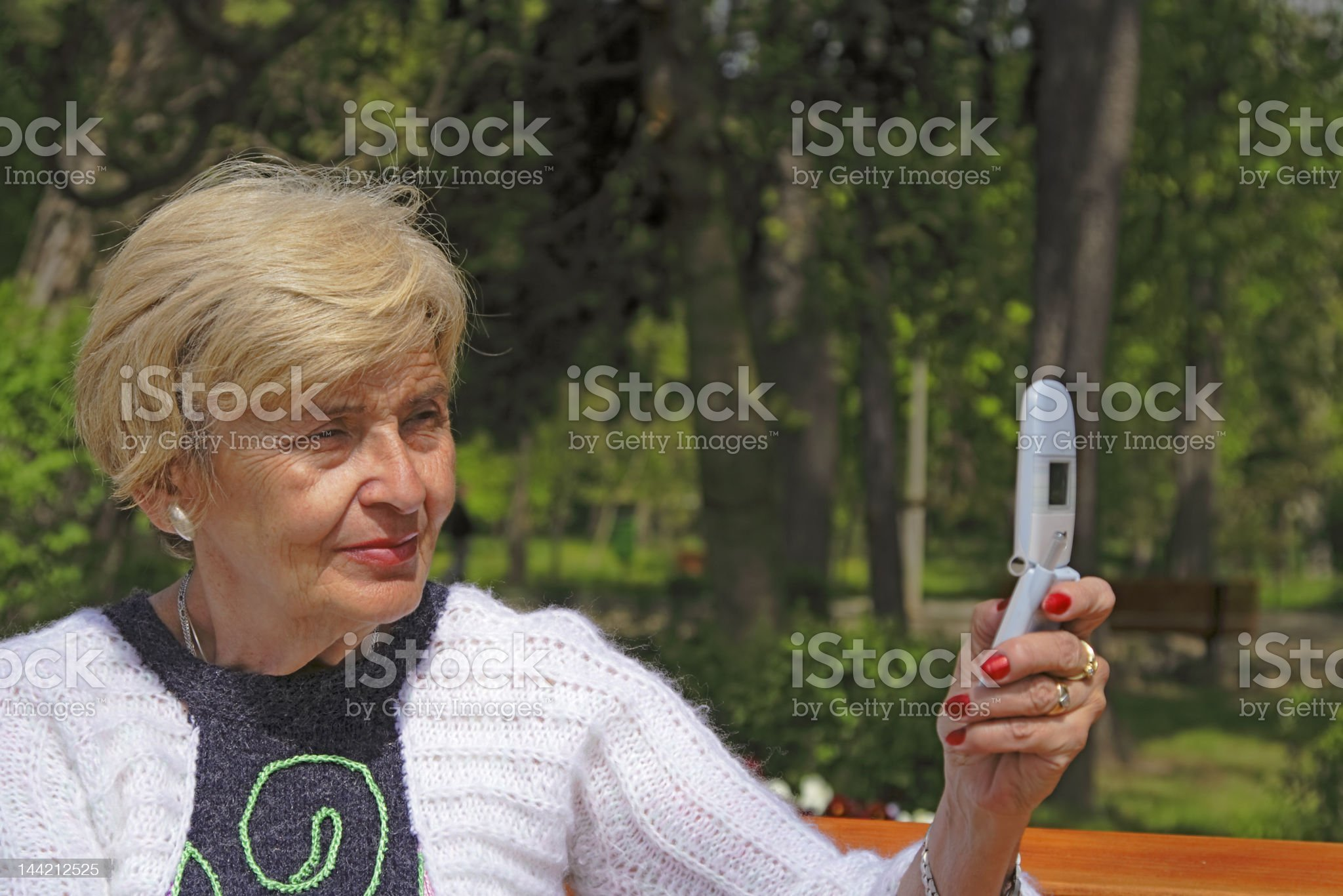 Senior woman with camera phone royalty-free stock photo