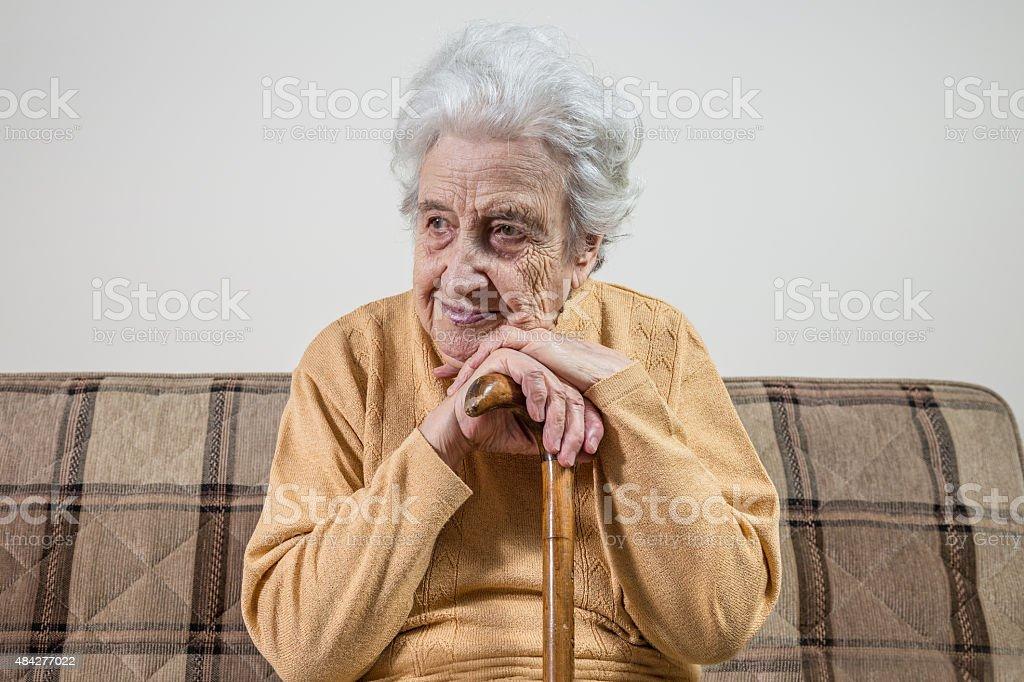 senior woman with cane stock photo