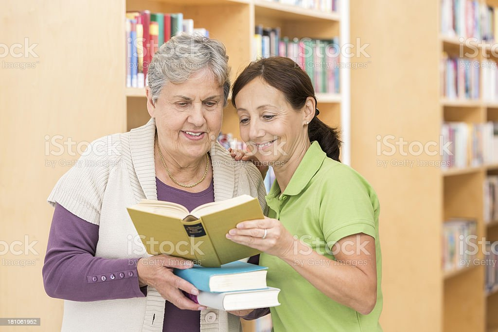 Senior woman with caregiver royalty-free stock photo