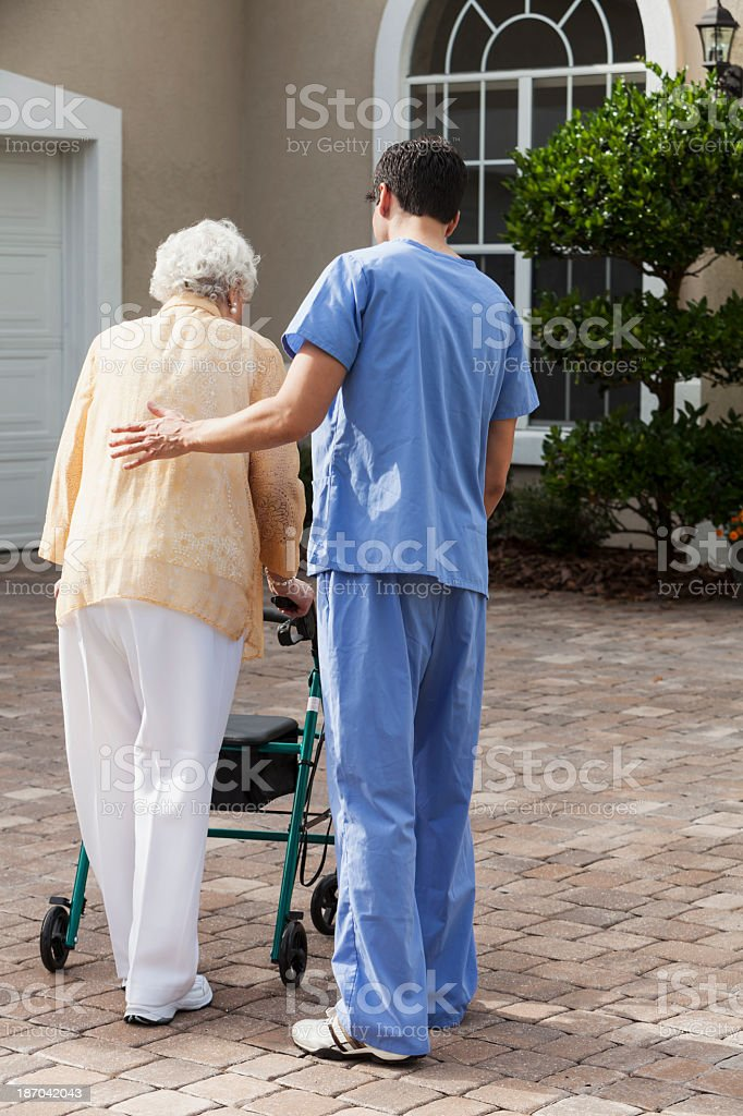 Senior woman with caregiver stock photo