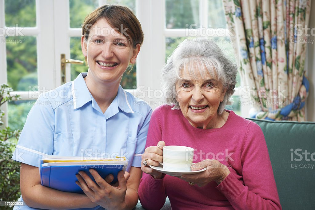 Senior Woman With Carer At Home royalty-free stock photo