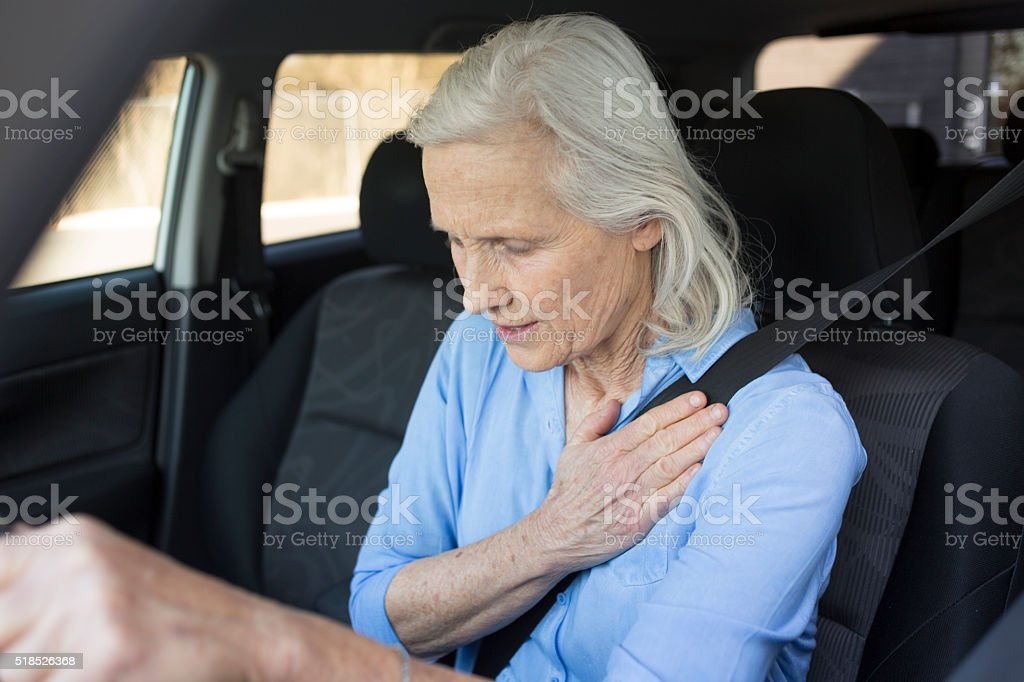 Senior Woman with Chest Pains Driving a Car stock photo