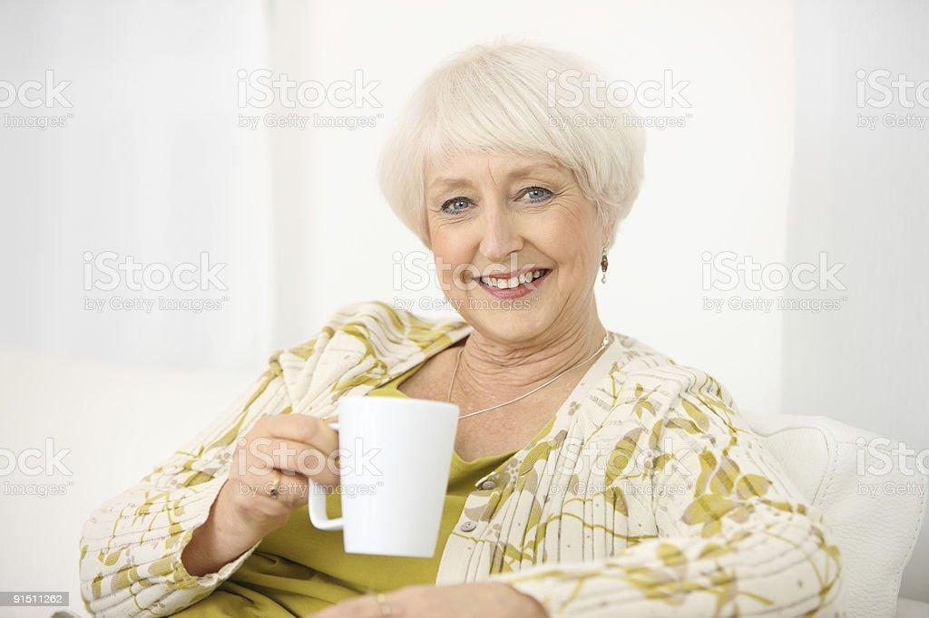 Senior woman with coffee mug royalty-free stock photo
