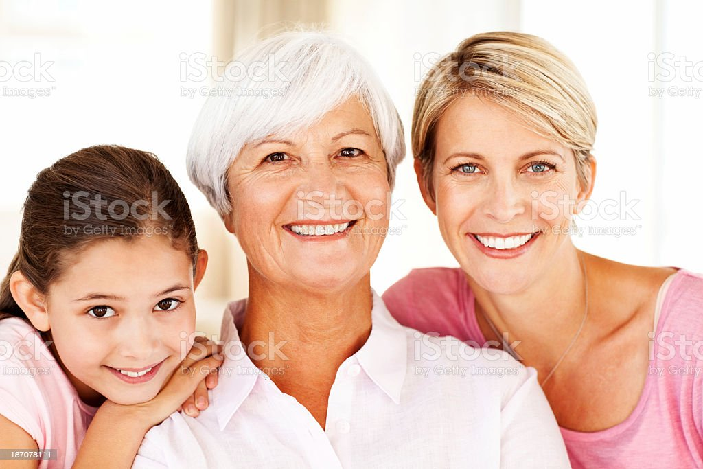 Senior Woman With Daughter And Grandchild At Home royalty-free stock photo