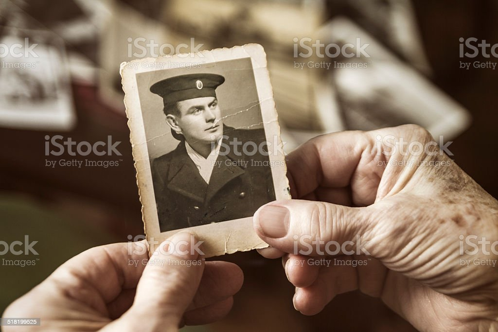 Senior woman with dear photograph of her husband stock photo