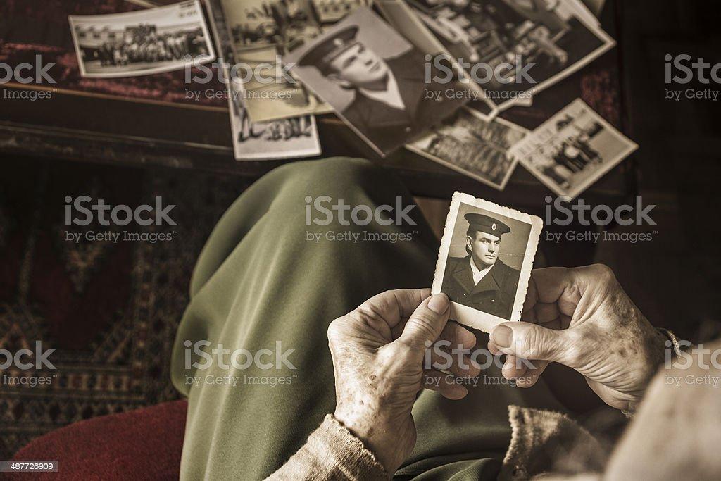 Senior woman with dear photographs stock photo